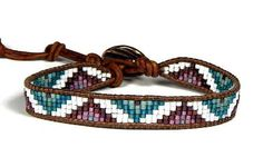 Loom Bracelet Seed Bead Leather Wrap Bracelet Purple Teal Mountains This is a loom bracelet in Delica beads, purple, teal and creamy white, on naturally dyed light brown leather cord from the USA. The pattern moves up and down, reminding me of the peaks and valleys in my normal day. On a