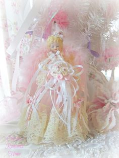 My beautiful mini pink shabby chic angel Christmas tree topper from Olivia's Romantic Home - Etsy :)