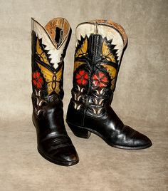 Tall black boots with inlaid yellow and blue butterflies, and red flowers with white leaves.  A white collar with pinked edges on the tops completes these outstanding boots. These have been worn, but are a long way from worn out. They were originally made for a man...I'd say a man who is confident....    The Blucher name is not in the boots but this is a known Blucher pattern, and definitely Blucher workmanship. Circa 1930.  One word....WOW!