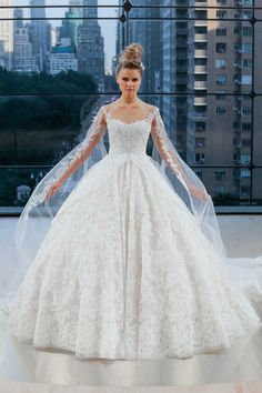 VANDERBILT Sleeveless illusion sweetheart classic ball gown with cathedral  length train and detachable sleeved veil.