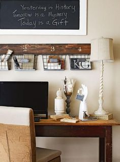 Organized vintage: Wire baskets attached to an old barnwood plank organize odds and ends above a desk. A framed chalkboard displays quotes. More ideas for decorating with vintage finds: www.midwestliving...