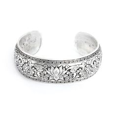 I don't wear alot of silver. But I like this. Looks great with casual clothes.  akt   Wide Carved Design Lotus Bali Cuff Bracelet