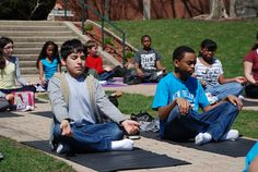 Middle School yoga students are working with Ms. Smoler on meditation and strength in yoga poses.