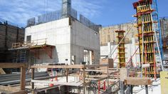 The SW core rising up-- the large opening in the side of the core wall is the freight elevator opening through which large objects such as the Tuskegee plane and slave cabin will eventually be delivered into the History galleries.