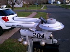 """A DIY """"Star Trek"""" mailbox boldly sits near the street and collects deliveries. The NCC-USPS includes a solar panel for potential journeys through the dark of space. Funny Mailboxes, Unique Mailboxes, Painted Mailboxes, Custom Mailboxes, Diy Mailbox, Mailbox Ideas, Mailbox Designs, Rural Mailbox, Mailbox Makeover"""