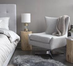 Emmerson swivel chair with whitewash, round Salish stumps and June bed. Featuring a durable blended fabric in vintage pewter and a silver swivel, our upholstered Emmerson occasional chair is a Scandinavian-inspired Mod masterpiece.