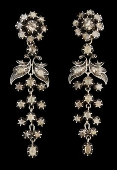 A pair of 19th cent, silver and diamond earrings.
