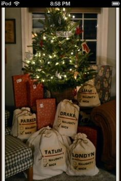 Drawstring bags with names on it from Santa! Cute!!