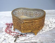 vintage gold filigree heart shaped jewelry vanity box.