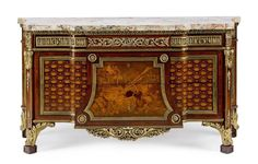 A French late 19th century Louis XVI style ormolu-mounted amaranth, sycamore, marquetry and parquetry breakfront commode after a model by Jean Henri Riesener: