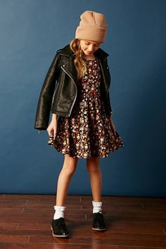 Forever 21 Girls - A knit dress featuring an allover floral print, skater silhouette, cap sleeves, and a round neckline.