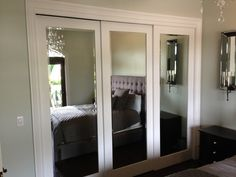 Closet Doors for Bedrooms: Choose Right Style to Your Room : Wide Trim on Sliding Mirrored Closet Doors