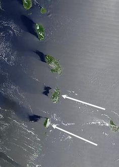 Levitating islands in The Bermuda Triangle observed by satellite? Islands in the Bermuda Triangle were photographed levitating by as much as 10 miles off the surface of the ocean in this recently declassified image from a U.S. spy satellite.  Follow link for story.: