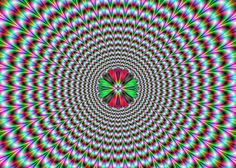 pulsating optical illusion on eye-illusions.com  The image below is not moving. It's your eyes playing tricks again