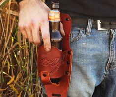 Leather Beer Holster  Become the drunkest gun in the west faster than anyone else by drawing a frosty brew out of the leather beer holster. Made from genuine leather this holster gently cradles your bottle of suds so its always ready when you are.  $24.99  Check It Out  Awesome Sht You Can Buy