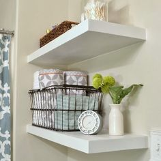 Make your own Floating Shelves for any room in the house!  So clean, crisp and beautiful! I reaaaallly want to do this in my bathroom!!!!