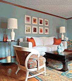 Aqua and terracotta living room, with white accents.  The end tables are way too high for the sofa.