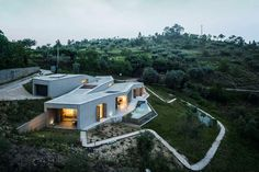 Casa na Gateira by Camarim Arquitectos in Portugal residential architecture concrete Architecture Résidentielle, Amazing Architecture, Villa, Casa Magna, Hillside House, Hillside Landscaping, Design Case, Outdoor Spaces, Indoor Outdoor