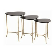 Black and gold is always a classy color combination, and these nesting tables are no exception. They are crafted from black marble and iron with a gold leaf finish.