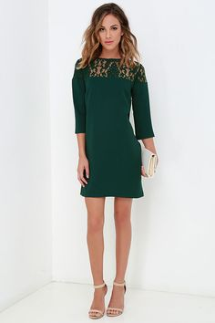 Kick your style game up a notch with the BB Dakota Keagan Dark Green Lace Dress! This lovely shift begins with a lace decolletage that joins the relaxed, woven three-quarter sleeves and darted bodice. Breezy and easy-to-wear shift silhouette completes the ensemble. Hidden clasp and keyhole at back. Unlined. 100% Polyester. Hand Wash Cold or Dry Clean.