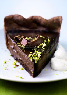 """Chocolate Pistachio Pie: """" Recipe created by Cheryl Slocum Okay, so the Pilgrims didn't eat chocolate. But surely they would have if they'd been offered a pie as blessedly dense and rich as this one, made with a filling of dark chocolate custard nestled in a tender, cocoa-flavored crust."""" - Oprah.com"""