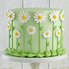 Fresh as a Daisy Cake Our favorite fresh-look flower, the daisy forms a fun covering for the sides of this cake. The centers are dusted with yellow sugar to add sparkle, making this cake a sensation at celebrations, indoors and out! Pretty Cakes, Cute Cakes, Beautiful Cakes, Amazing Cakes, Cake Decorating Techniques, Cake Decorating Tips, Cookie Decorating, Birthday Cake Decorating, Daisy Cakes