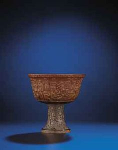 A RARE AND FINELY CARVED RHINOCEROS HORN 'HUNDRED BOYS' STEM CUP   LATE MING/EARLY QING DYNASTY, 17TH CENTURY