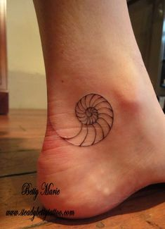 I love the placement of this nautilus tattoo. It's simple and just great.