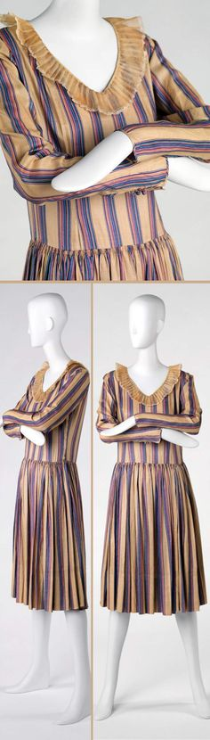 """Lanvin, 1928. Printed silk. Rhode Island School of Design Museum: """"[T]his dress exudes a childlike charm in its playful pattern and slightly oversized organza collar. The collar and the pleating at the hip nod to robe de style type of dress, an 18th-century-inspired look that Lanvin frequently presented in her collections. The signature color of the House of Lanvin was the blue tint seen here in the stripe. Lanvin open[ed] her own factory to fabricate 'Lanvin blue.'"""""""