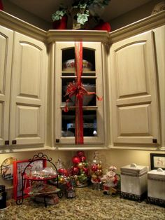 Wrap ribbon with a bow around kitchen cabinets - What a great decor idea!