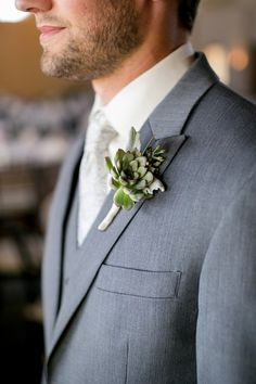 Groom in gray suit with green succulent boutonniere pinned to his lapel {Jeannine Marie Photography}