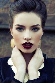 Dark red lips are one of our favorite fall makeup trends. Makes me wish I had blue eyes!