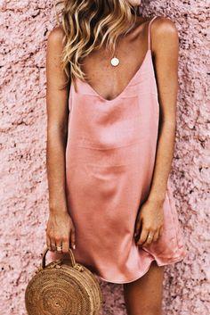 Blush satin slip dress + woven bag.