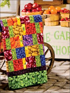"""Now you can visit the farmers market every day! Juicy fruit prints are strip-pieced to create a luscious throw or bed cover. This e-pattern was originally published in 5-10-15+ Fat Quarters. Size: 51 1/2"""" x 63 1/2"""". Skill Level: Beginner"""