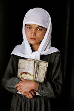 This young school girl was photographed in Herat, Afghanistan.    By Steve McCurry