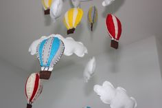 This hot air balloon mobile adds a whimsical accent to this neutral room. #projectnursery