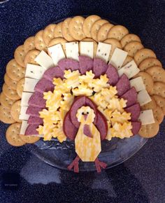 Thanksgiving/Turkey - Cheese, Crackers and Salami Tray! A fun and easy way to add a little fun to your holiday table! We used peppercorns for the eyes. Be creative - use cutouts for the cheeses or just keep them rectangle. We used a leaf (from pampered chef) to cut a few!