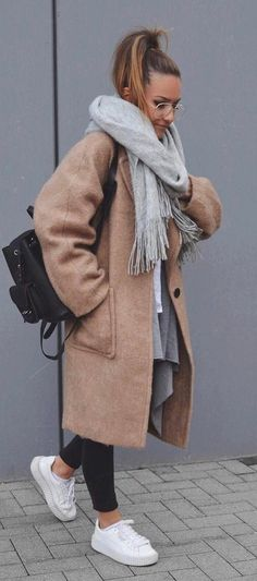 how to wear a cashmere coat : sacrf + bag + skinny jeans + sneakers + top