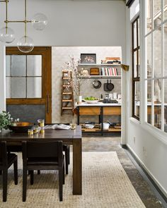 The conference room in the office has the warm feel of a home's dining room.