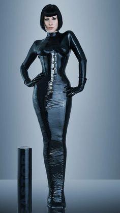 Half bound in dark cellophane #bondage tape and #latex model.