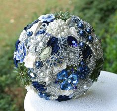 this is gorgeous...but I thought $75 was a lot of $$...that is just the deposit. Green and Navy Blue Wedding Brooch Bouquet. Deposit on a made to order Heirloom bouquet. Broach Bouquet