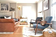 Rosa Beltran Design Blog LEATHER TUFTED DAYBED MADE BY ROSA BELTRAN DESIGN AFFORDABLE CUSTOM FURNITURE IN LOS ANGELES SHIPS NATIONWIDE living room sofa chair vintage caramel cognac camel brown brass light sconce fireplace wall art black white photography ethnic pillows navy peter dunham fabric vintage swing arm floor lamp crate barrel bar cart gold mantle styling overdyed rug neutral cowhide mid-century mid century channel tufted chairs armchairs benjamin moore 1542 himalayan trek ikat