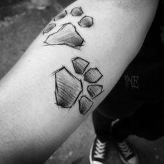 Sketch style paw print tattoos by Inez Janiak