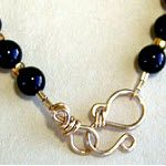 """S"" Hook Clasp handmade out of gold jewelry wire shaped on WigJig jewelry making tools."