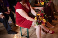 Bridesmaids in short red dresses and red shoes and bright and colourful bouquets.  http://www.lillianandleonard.com/