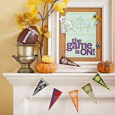 "Use your guests' favorite teams to help decorate! Add this pennant banner and our ""the game is on"" banner for quick and easy football decorations! Download ""the game is on"" banner here: http://www.bhg.com/party/birthday/themes/throw-a-football-party/?socsrc=bhgpin090813footballpartydecorations#page=9"