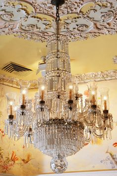 Imagine buying various moulding pieces and custom arranging them around the ceiling to accentuate your chandelier... Vintage Waterford chandelier
