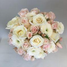 #gardenroses #sprayroses #gerbera #pomponi  #blush clutch bridal bouquet of blush colored fresh flowers including garden roses, spray roses, pomponi gerbera daisies designed by #SunnycrestFlowers