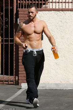 Pecs appeal: Artem Chigvintsev showed off his buff body as he left the dance studio in Hollywood on Saturday