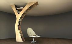 Very cook bookshelf design for rooms with no extra wall space; it's attached at the ceiling so it can be put anywhere.